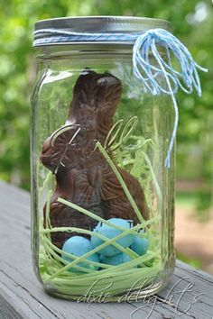 Fill a Mason Jar with an unwrapped chocolate Easter bunny, edible grass, and candy eggs for a visually appealing Easter treat. Get the recipe at Dixie Delights.   - CountryLiving.com