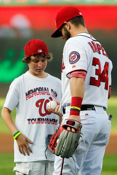 Bryce always has time for the young'uns. We saw him stop to talk to a young boy after Natsfest was over. (Last year)