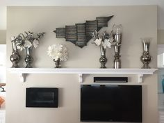 Awesome submission from Yeager Design & Interiors of a Contemporary Mantle setting they designed using our Metallic glass vases Design Interiors, Interior Design, Living Room Mirrors, Submission, Home Decor Accessories, Mantle, Floating Shelves, Vases, Glass Vase