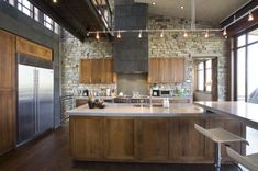 http://www.homedit.com/add-some-rustic-charm-to-your-kitchen-with-stone-walls/