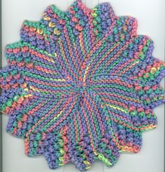 This is a variation of Amy Carpenter's Round Dishcloth. I tightened up the gauge to make it more durable, and reduced the number of stitches to 18 to make it smaller. I also added a slip stitch edge and some extra yarn overs for decoration.