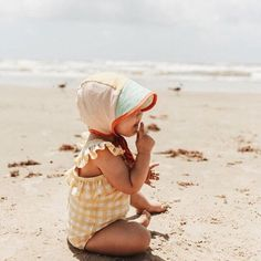 The sweetest customer share from our Instagram! Briar bonnet at the beach! Shop by clicking through! #briarhandmade #baby #summer #beach #kid