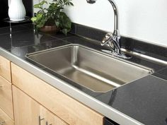 HGTVRemodels' Kitchen Countertop Buying Guide gives you expert tips for choosing the right tile countertops for your kitchen renovation. Kitchen Tiles, Diy Kitchen, Kitchen Decor, 10x10 Kitchen, Soapstone Kitchen, Kitchen Cupboard, Cheap Kitchen, Granite Tile Countertops, Cheap Tiles
