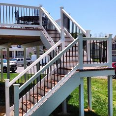 Decking is capped PVC WOLF deck in Amberwood with @Deckorators Railing and Accessories Railing and Accessories. Great work!