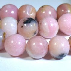 Pink Opal Round Beads - 12 count - It is especially noted for its energies in healing emotions.  Wear or hold pink opal while in meditation to help to bring compassion and a gentle resolution of painful memories.