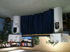 Castle towers flank our preschool puppet show stage.  Towers made from cardboard concrete forms and topped with a box.