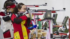 The two Chinese teammates Wu Liuxi and Chang Jing stood together atop of the 10m Air Rifle Women podium, at the 2013 ISSF World Cup in Rifle and Pistol events in Fort Benning, GA, USA