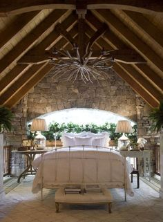 beautiful white bedding and log ceiling
