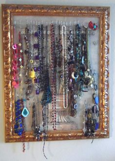 This is how I organize my Necklaces.  Take an old canvas painting, spear with drapery hooks and hang necklaces.
