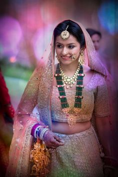 Indian Wedding Jewelry - Polki Set and Raani Haar | WedMeGood | Bride in a Gold Lehenga with a Polki Necklace and an Emerald and Gold Raani Haar #wedmegood #indianbride #indianwedding #emeralds #polki #gold #lehenga