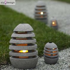 Lampy ogrodowe jak kamienie - zdjęcie w galerii pomysłów Styl