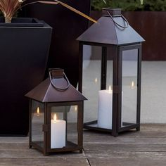 Knox Small Bronze Metal Lantern - Crate and Barrel Outdoor Candle Lanterns, Large Lanterns, Lantern Candle Holders, Metal Lanterns, Small Patio Ideas Townhouse, Traditional Lanterns, Patio Wall, White Candles, Hallway Decorating