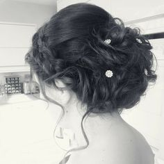 Soft curly updo with plait