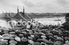 Limited, signed art prints by Bruno Bourel. You can order them only in our webshop : http://rododendronart.com/raining-umbrellas Budapest, Hungary, 1994