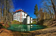 Once upon a time by Gitta Sladič on 500px-  Snežnik Castle (Slovene: Grad Snežnik, German: Schloss Schneberg) is a 13th-century castle located in the southwest part of the Lož Valley near the settlement of Kozarišče in the municipality of Loška Dolina, country Slovenia. Its name is coincidentally identical to a univerbation based on the Slovene word sneg 'snow', but is actually a Slovenized form of the name of the noble house of Schneberg, whose possession it initially was.