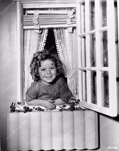 Shirley Temple plays in her custom doll house at Fox Studios 563-07