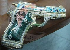 STRANGE CUSTOM GUNS - MUAMMAR GADAFFI'S - AUTOMATIC MADE OUT OF PURE GOLD HAS HIS NAME WRITTEN ON IT!
