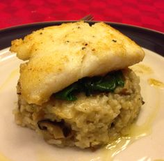 Wild mushroom risotto with truffle oil, halibut with Lemon brown butter, spinach & kale.