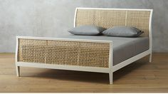 "<span class=""copyHeader"">total dream.</span> The quintessential American sleigh bed—-sturdy, timeless, formal-ish—-gets a modern makeover in this elegant design by Mermelada Estudio. Soft, sinuous silhouette is a head to toe dream in solid mahogany painted bright white. Laid-back rattan weave cuts through the old formality for a beach house meets urban loft attitude. Open, airy and off-the-charts elegant—-this is what a master bed looks like. Mattresses available, sold separately.<br /><br…"