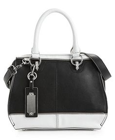 Well, actually, I bought this bag today!!! I love it!!!!! Carol, STOP yourself!!!!