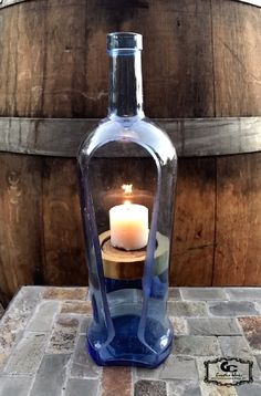 Sanctuary Candle Holder bottle crafts with candles Wine Bottle Candles, Recycled Glass Bottles, Glass Bottle Crafts, Wine Bottle Art, Painted Wine Bottles, Diy Bottle, Bottle Lights, Wine Bottle Holders, Cut Wine Bottles