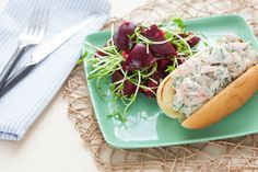 Salmon Roll Sandwiches with Baby Beet & Pea Shoot Salad. Visit https://www.blueapron.com/ to receive the ingredients.