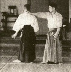 "Yoshinkan Aikido Founder Gozo Shioda taking ukemi for Aikido Founder Morihei Ueshiba in the 1938 technical manual ""Budo"" - from the blog post ""Aikido Shihan Kyoichi Inoue - Learning from the Kojiki"": http://www.aikidosangenkai.org/blog/aikido-shihan-kyoichi-inoue-kojiki/"