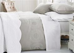 Next duvet cover, plain so that colour can be added elsewhere