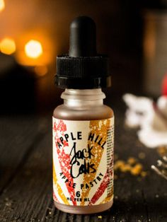 Jack Cali's Apple Hill (15ml) - Fruit notes of raisin and apple, paired with a pastry crust that is smooth and lovely to vape. Aspirationally, the flavour is designed to conjure up, home, warmth, and comfort food. Think of a dark den, plush in antique leathers, with a fire roaring, a whisky in your hand and your dog at your feet. You, sir, have arrived. You live on Apple Hill.  Made in California USA by Jack Cali's, supplied by Next Vape