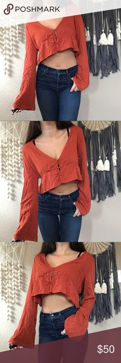 Tobi burnt orange belle sleeve crop top ⚡️NO trades  ⚡️open to ALL offers!  ⚡️ bundle for MAJOR discounts!  ⚡️feel free to ask any questions ⚡️ I will not respond to offers in the comments, please use the offer button for all offers.  ⚡️model is 5'7 and typically wears a small/26.  ⚡️All sales are final and all offers are binding.  ⚡️ If I miss your comment, please comment again! Tobi Tops Blouses