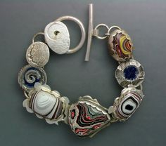 Fordite and sterling.