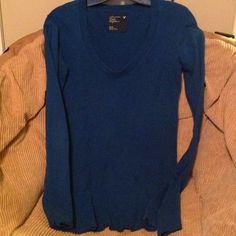 American Eagle long sleeve top Size medium, great look and great fit. Great comfortable top and beautiful blue color. Smoke free home American Eagle Outfitters Tops Blouses