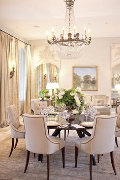an elegant  understated dining room. i like the sitting area against the wall