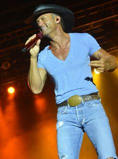 tell me someone who can rock a v neck and skinny jeans better....NO ONE.