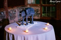 We love this At-At cake! Any Texas couples looking for a kick-ass photographer? Mary Cyrus Photography is offering a $100 print credit for anyone who name drops us when they book. Maybe now is the time to go see if your date is available? http://vendors.offbeatbride.com/listing/mary-cyrus-photography