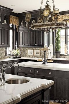 Beautiful kitchen design with black cabinets.