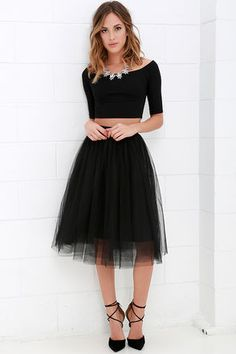 You never know what romance could be around the next corner, so be prepared with the Urban Fairy Tale Black Tulle Skirt! A playful silhouette begins with a soft elastic waistband from which voluminous layers of tulle fall to a midi-length hem.