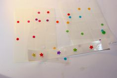 homemade enamel dots, Enamel dots can be rather bulky, not good through the mail. These are punched out shapes, stuck one gluedots (just leave them on the sheet) colored with markers and then topped with glossy accents. once dried they are nice and shiny and have a bit of dimension to them. if you have coloured cardstock that coordinates with your project  no need to color, so even easier, try patterned paper ans use up scraps