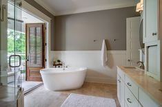 Gray wall with wood trim bathroom traditional with tile floor soak tub