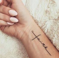 "[ ""Twenty Very Popular Tattoo Ideas for Women to Try:"", ""When the world seems like a dark and unforgiving place, faith is what gets us by. Faith Tattoos is a great way to sure to remind you that you will…"", ""tbh i just like the lettering on that faith tat"", ""for the foot, add a few small footprints and the word, \""by\"" .\""walk"
