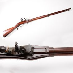 Hall Breechloading Flintlock Rifle- The iron mounts (and barrel) of this M1819 flintlock Hall rifle  are coated with a durable brown lacquer that provides a distinctive color.  This lacquer helped protect from rust and was found to be faster to apply than a blued finish.  On a piece like the Hall – made from 1819 up to 1840, this innovation probably helped in the production of the nearly 20,000 Hall flintlock rifles made at Harpers Ferry Armory. At the NRA National Firearms Museum in…