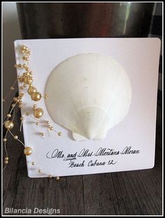 Shell and pearls place card by Bilancia Designs for a beach wedding.