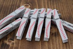 Baseball Clothespins Set of 10 ~ Regular Size Wood Clothespins See our Dont Say Baby Baseball printable clothespin shower game here: https://www.etsy.com/listing/400665281/dont-say-baby-game-dont-say-baby ~AND~ NEW Plastic Baseball Party Cups: https://www.etsy.com/listing/459120328/baseball-baby-shower-baseball-party-cups We now have Softball, Basketball, and Football Clothespins in our Shop! Softball Clothespins: https://www.etsy.com/listing/399874055/softball-clothespins-softball-...