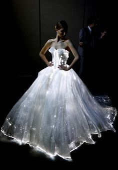 IMAGE DISTRIBUTED FOR ADOBE - Fashion designer Zac Posen talks with the press while showing off his light-up, fiber optic dress at Adobe MAX, The Creativity Conference, on Thursday, Nov. 3 , 2016 in San Diego. (Denis Poroy/AP Images for Adobe) AP Images for Adobe