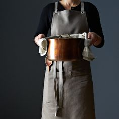 Bark Kitchen Apron - Sturdy nickel-plated grommets and slate grey ties make this stylish apron easy to adjust (and fun to wear). Go ahead, make a mess in your kitchen. Studiopatro knows linen -- this apron will hold up.