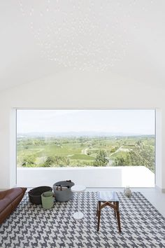 Four volumes repeated in sequence and inscribed in a regular pattern compose Artelabo's Quiet House, located on tiny plot of land with a gorgeous view on the Hérault Valley #window #view