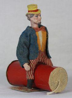 Antique German Uncle Sam Nodder riding a Firecracker Candy Container c1910