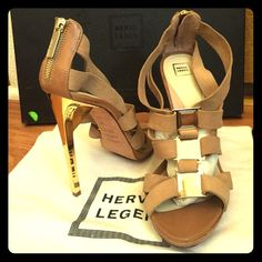 ✨HERVE LEGER ✨Leather Sandal SALE New with a box.Accented with glamorous metal details, this strappy sandal is essential to creating truly captivating looks. Open toe. Metallic heel. Strappy vamp with metal hardware accents. Rear zipper closure at ankle. Leather. Herve Leger Shoes