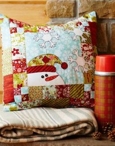 Frosty Friend by designer @Sherri Falls.    A fast-to-fuse appliquéd snowman will impart a friendly welcome all winter long.