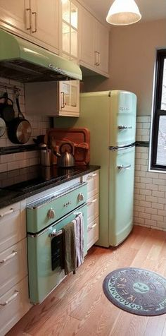 #BigChill kitchen in Jadite Green that features a range, fridge, microwave & hood. Click now to start building your dream vintage kitchen!
